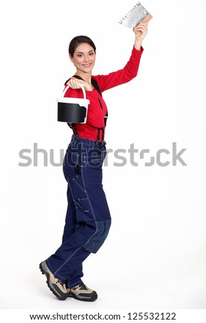 Woman holding a pail and a scraper - stock photo