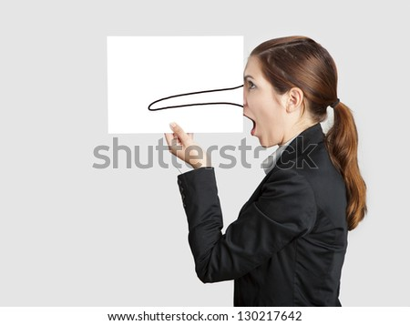 Woman holding a  paper sheet with a sketch of pinnochio nose on it - stock photo