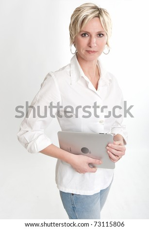 Woman holding a PC tablet with a happy expression. Please note that the logo on the pc tablet is not real. I am attaching a property release