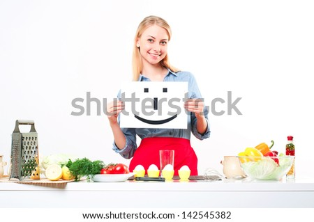 woman holding a plate with smile mark - stock photo