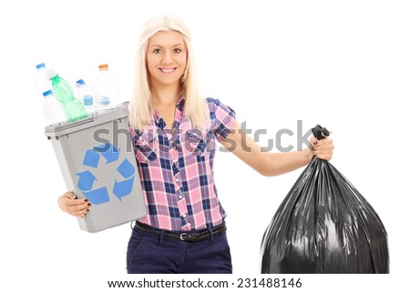 Woman holding a recycle bin and a trash bag isolated on white background - stock photo