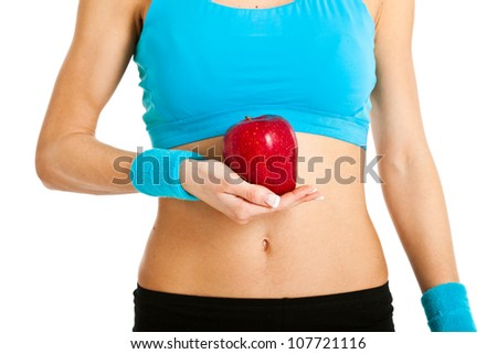 Woman holding a red apple - stock photo