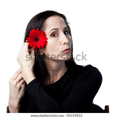 Woman holding a red daisy, isolated studio image