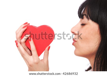 Woman holding a red heart in her hands