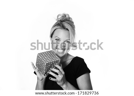 woman holding a small present think what could be inside