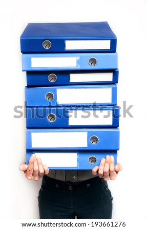 Woman holding a stack of folders - stock photo