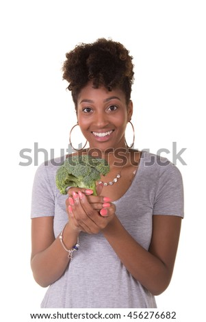 Woman holding a stalk of broccoli