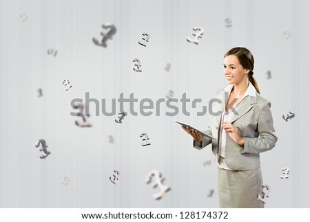 woman holding a tablet, fly around the three dimensional signs pound - stock photo