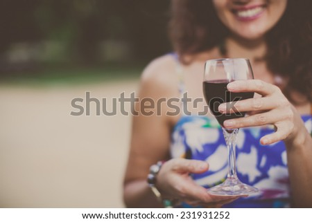 Woman holding a wine glass. - stock photo