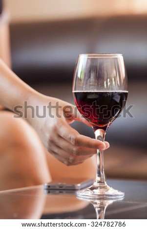 Woman holding a wine glass.