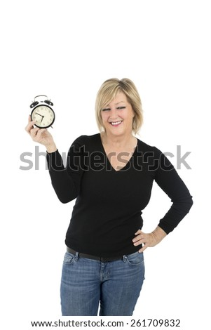 Woman holding an alarm clock against a white background - stock photo