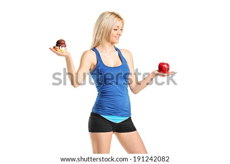 Woman holding an apple and a cake isolated on white background - stock photo