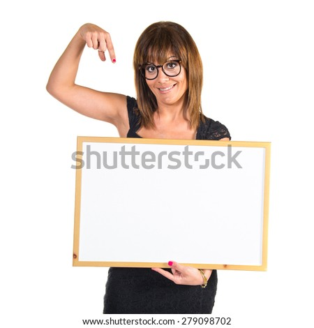 Woman holding an empty placard  - stock photo