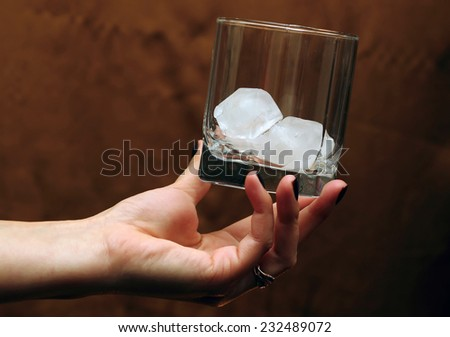 Woman Holding an glass with ice in Her Hand
