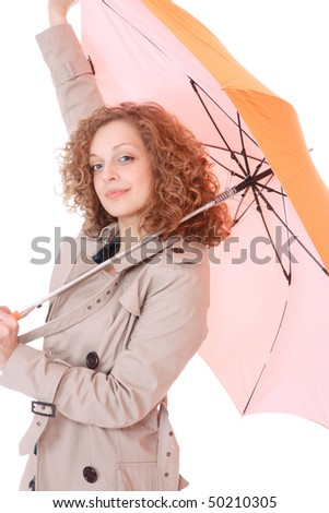 Woman holding an umbrella wearing trenchcoat standing on white