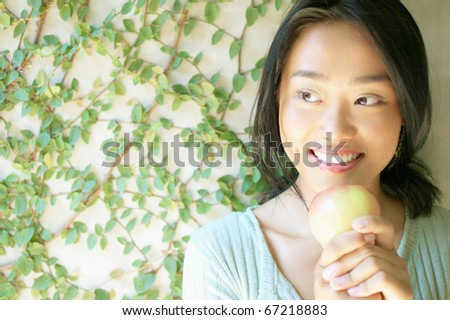 Woman holding apple outdoors
