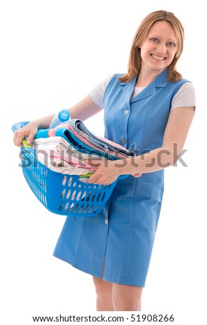 woman holding basket of laundry and looking at camera
