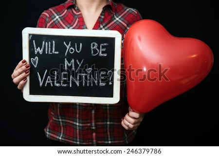 "Woman holding ""be my valentine"" sign - stock photo"