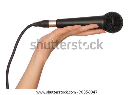 woman holding big black microphone for singing - stock photo