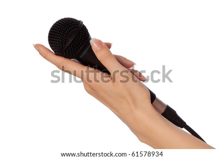 woman holding big black microphone for speech - stock photo