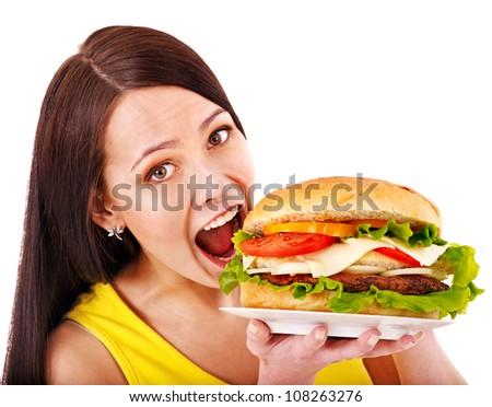 Woman holding big hamburger. Isolated. - stock photo