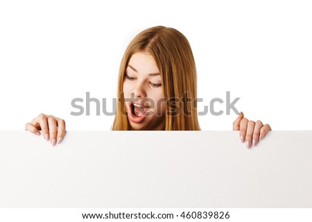 Woman holding big white blank card. Positive emotional portrait of happy girl with long hair.