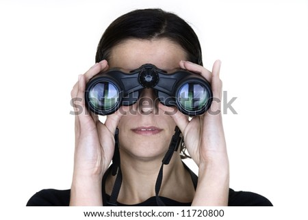 woman holding binoculars in white background - stock photo