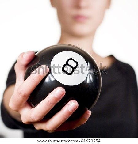 Woman holding black 8 ball - stock photo