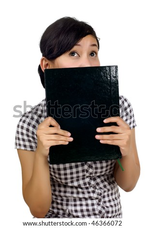 Woman holding book on the face isolated on white background