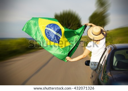 Woman holding Brazil flag - Sport fans traveling to Rio de Janeiro - stock photo