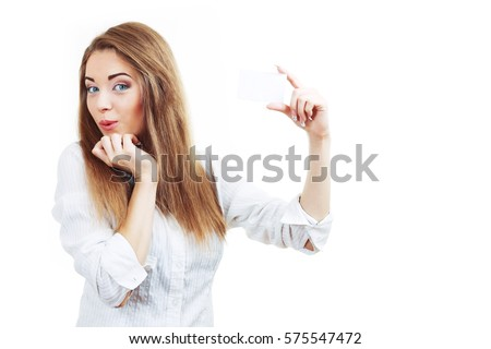 woman holding business card over white looking surprised stear at something