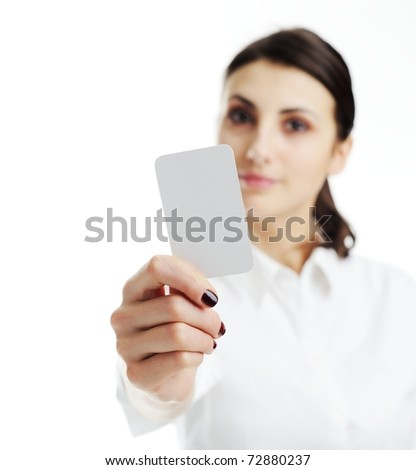 Woman holding businesscard in hand. Focus on card. - stock photo