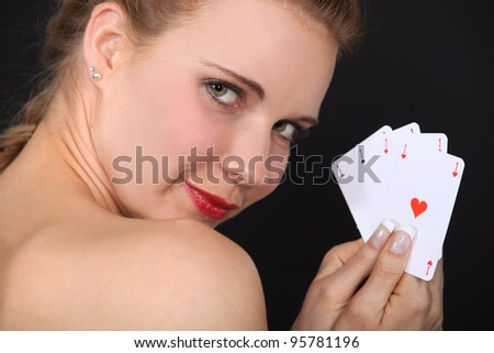 Woman holding cards - stock photo
