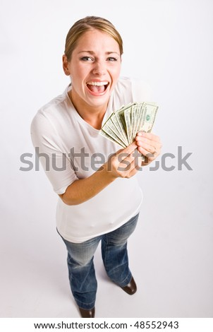 Woman holding cash - stock photo