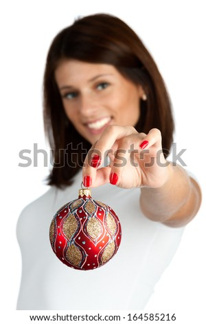 Woman holding christmas red ball, close-up of hands. Shallow DOF. - stock photo