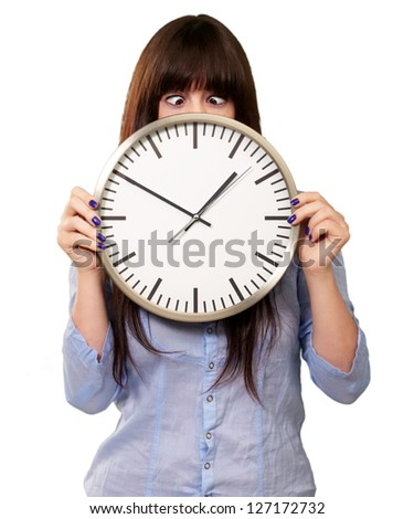 Woman Holding Clock With Squinted Eyes Isolated On white Background - stock photo