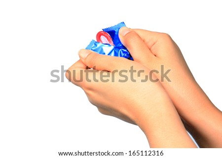 Woman holding condom in hand,Hand holding a condom in package,isolated on white background - stock photo