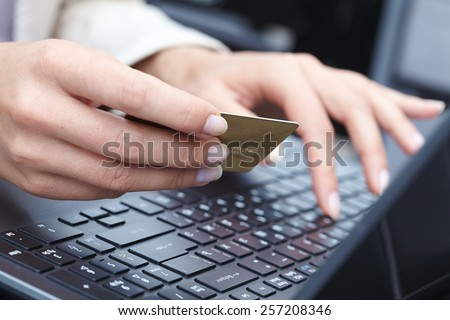 woman holding credit card on laptop for online shopping concep - stock photo