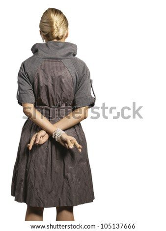 woman holding cross fingers behind her back - stock photo