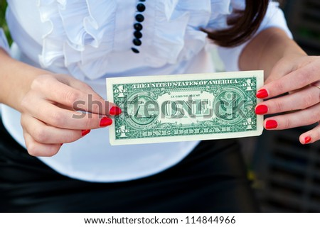 woman holding dollar upside