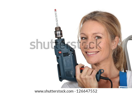 Woman holding electric drill - stock photo