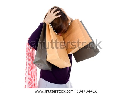 Woman holding few shopping bags isolated on white background. - stock photo