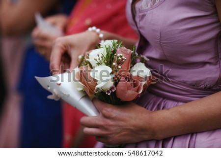 woman holding flowers at a wedding