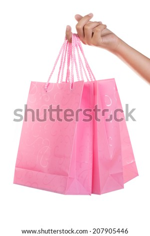 Woman holding gift bags on white isolated background