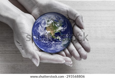 Woman holding global in hands , Elements of this image furnished by NASA - stock photo