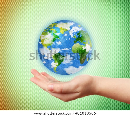 Woman holding globe on her hand on abstract green background