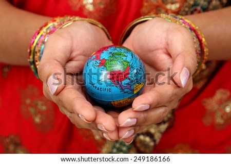 Woman holding globe on her hands - stock photo