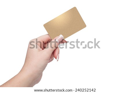 Woman holding gold credit card in hand - stock photo