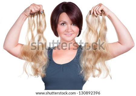 Woman holding hair extensions - stock photo