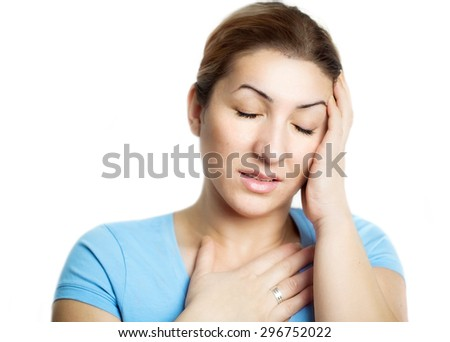 Woman holding hand on head, feeling stress, depression and pain - stock photo